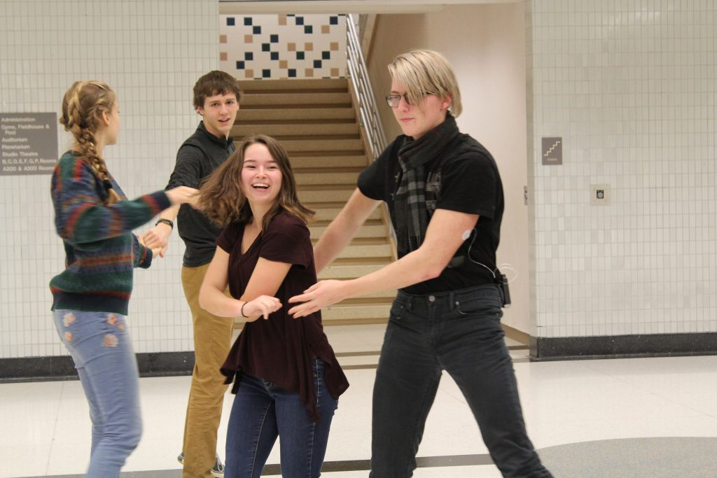 Students practice their dancing in swing dance club afterschool outside of the main cafeteria